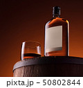 Glass and bottle of whiskey 50802844
