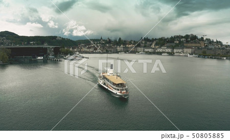 Aerial view of a tour ship on the lake against Lucerne cityscape, Switzerland 50805885