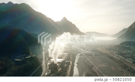 Aerial view of air polluting plant in mountainous area 50821050