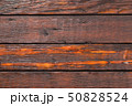 Wooden planks background, weathered, with nails. 50828524