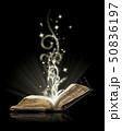 Open book magic on black  50836197