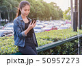 Woman using cell phone with traffic jam background 50957273