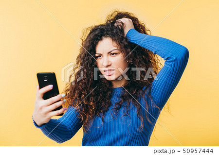 wtf mistake angry woman hair smartphone emotion 50957444