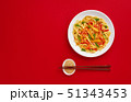 Fried noodles with chicken and vegetables. Asian food. Top view on red background 51343453