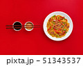 Fried noodles with beef and vegetables. Asian food. Top view on red background 51343537