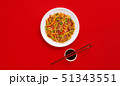 Fried noodles with beef and vegetables. Asian food. Top view on red background 51343551