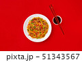 Fried noodles with beef and vegetables. Asian food. Top view on red background 51343567