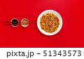 Fried noodles with beef and vegetables. Asian food. Top view on red background 51343573