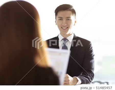 female Manager Interviewing A Young man In Office 51485457