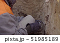 Man scientist ecologist getting samples of soil 51985189