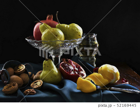 Still life with pomegranate, lemon, glass of wine, pear, walnut. Dark shadows, fruits in the style 52169445