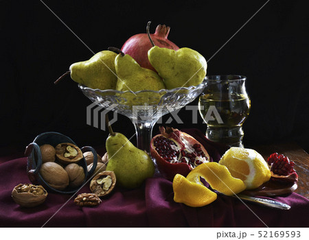 Still life with pomegranate, lemon, glass of wine, pear, walnut. Dark shadows, fruits in the style 52169593