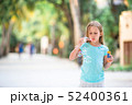 Adorable little girl making soap bubbles during summer vacation 52400361