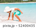 Adorable little girl drawing picture on white beach 52400435