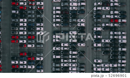 Aerial top down shot of a car factory new cars storage 52696901