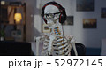 Skeleton with headphone sitting at computer 52972145