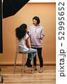 Makeup artist doing makeup to a model  52995652