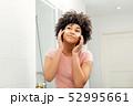 Mixed race woman in bathroom  52995661
