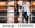 Young boxer talking with his mature instructor  52995692