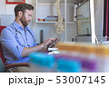 Male doctor using digital tablet in clinic 53007145