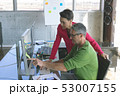 Attentive business people working at desk in creative office 53007155