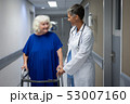 Mature female doctor talking with senior female patient in clinic at hospital 53007160