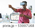 Graphic designer using virtual reality headset in office  53007168