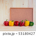 sweet peppers on wooden table. 53180427