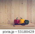 sweet peppers on wooden table background 53180429