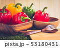 sweet peppers on wooden table background 53180431