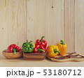 sweet peppers on wooden table background 53180712