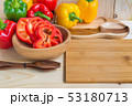 sweet peppers on wooden table background 53180713