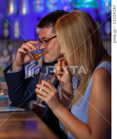 Young people drinking in the bar 53204287