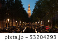 Night view of Amsterdam with canal and Zuiderkerk, Netherlands 53204293