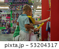 He wants all the toys in this shop 53204317