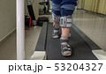 Child with foot drop system walking on the treadmill 53204327
