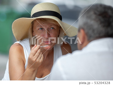 Mature woman in outside cafe 53204328