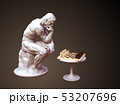 Sculpture Thinker Pondering The Chess Game On Brown Background 53207696