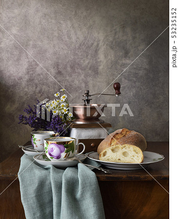 Retro still life poster breakfast. Vintage coffee grinder cups, silver spoon, homemade bread bakery 53235152