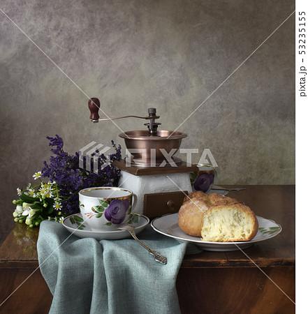 Retro still life poster breakfast. Vintage coffee grinder cups, silver spoon, homemade bread bakery 53235155