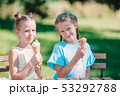 Little girls eating ice-cream outdoors at summer 53292788