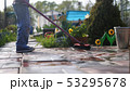 Young boy helps family cleaning the tile using a mop in garden 53295678