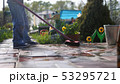 Young boy helps family cleaning the tile using a mop in garden 53295721