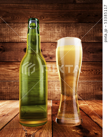 Bottle and a glass of light beer. 53385117