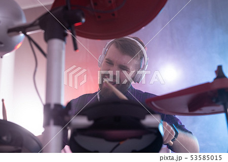 Hobbies, music and people concept - emotional guy playing on electronic drums on the stage 53585015