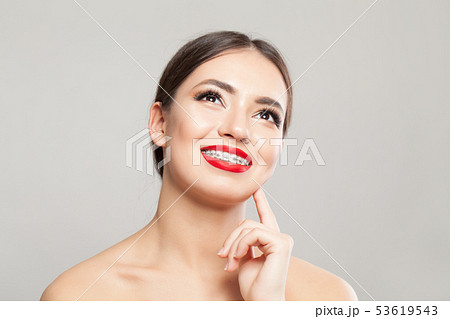 Cheerful young woman in braces portrait 53619543