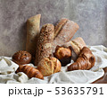 Different types of baking still life. Buns croissants, muffins and loaves, bread patties on textile 53635791