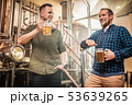 Two men tasting fresh beer in a brewery 53639265