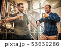 Two men tasting fresh beer in a brewery 53639286