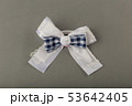 Children's hair ties on a gray background. 53642405
